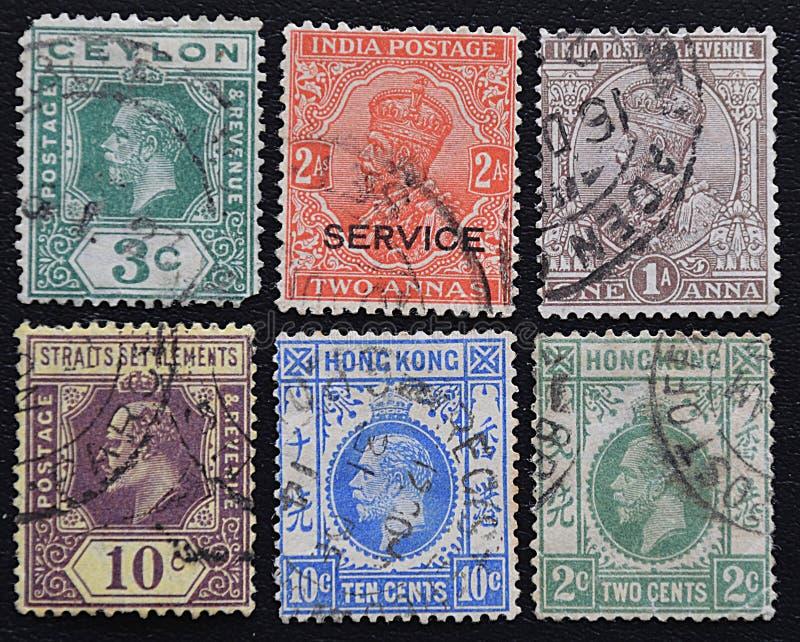 Серия старых штемпелей почтового сбора английских колоний стоковое фото
