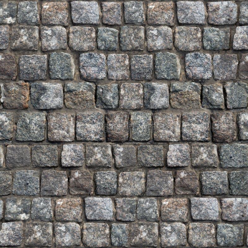 Серое старое каменное дорожное покрытие - безшовная текстура стоковое фото