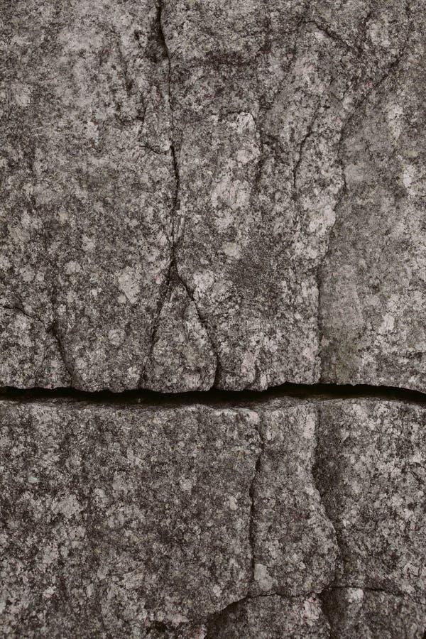Серые каменные текстура и предпосылка Закройте вверх по взгляду естественной текстуры стены утеса Абстрактные текстура и предпосы стоковое фото rf