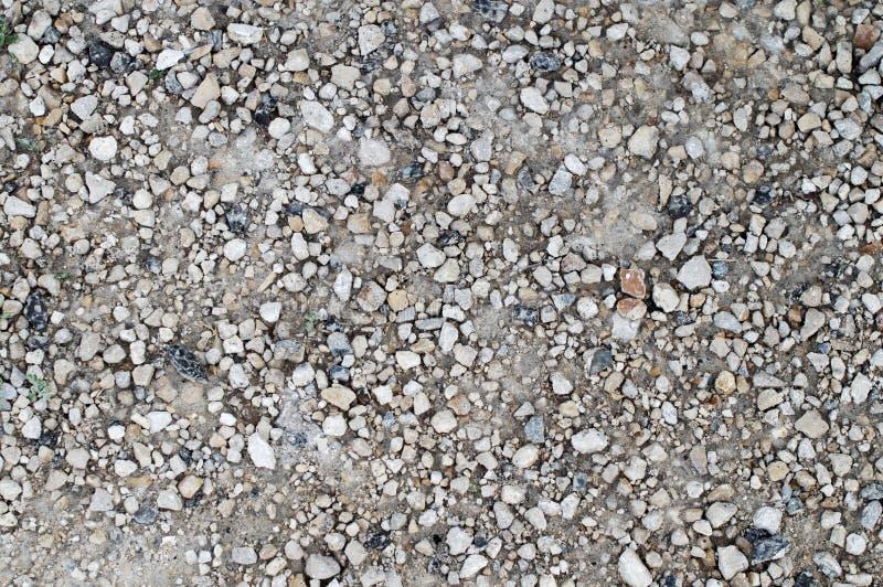 Серые камни на дороге стоковое изображение