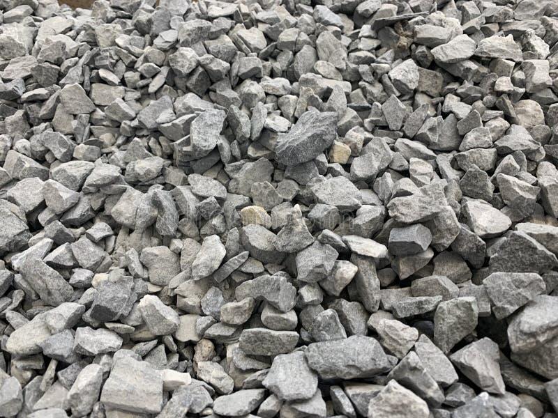 Серый небольшой мякиш гранита, строительный материал, простая предпос стоковое фото rf