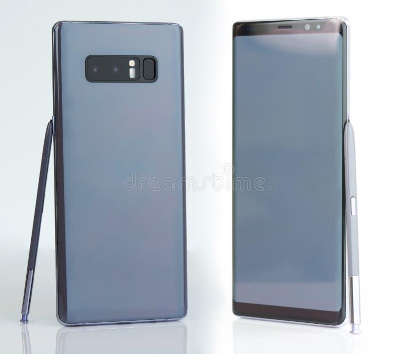 Серый smartphone с ручкой стоковое изображение rf