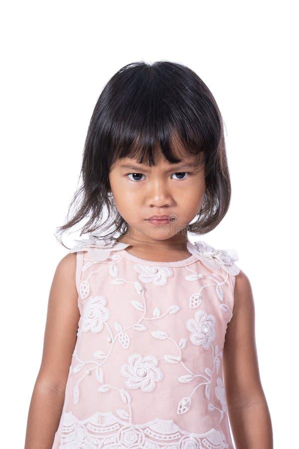Серьезное выражение азиатского женского малыша стоковые фото