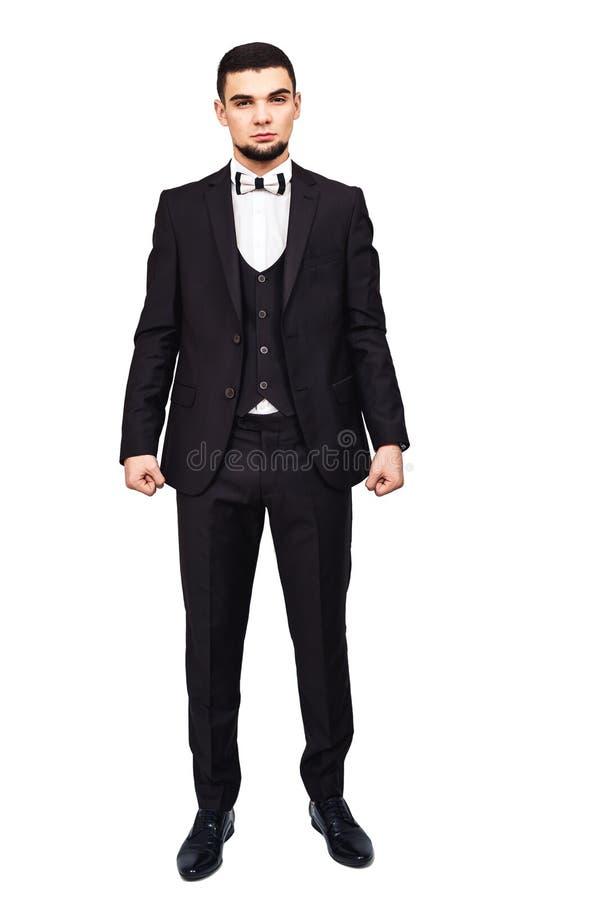 Серьезные строгие бизнесмен или босс в черном росте костюма полностью стоковые изображения