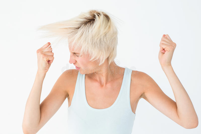 Сердитая женщина тряся ее голову стоковая фотография