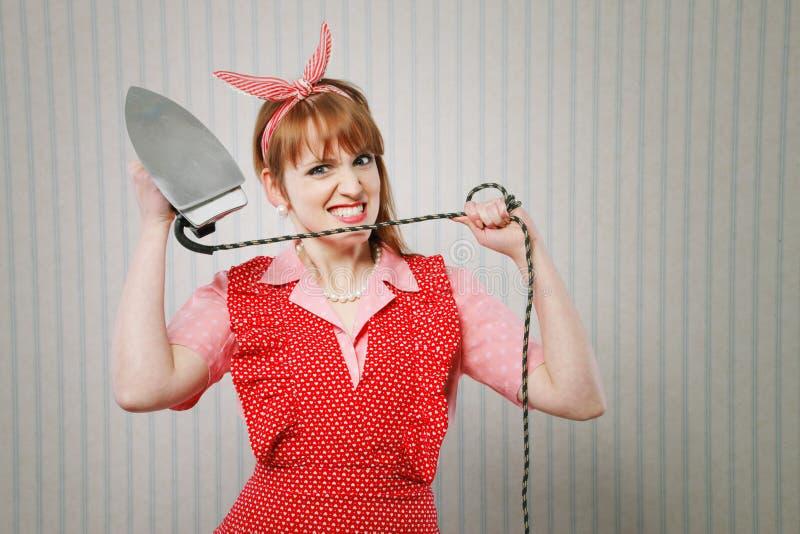 Сердитая домохозяйка стоковое фото