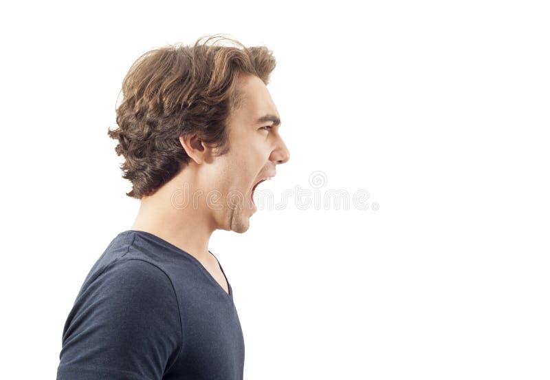 сердитые детеныши портрета человека стоковое изображение rf