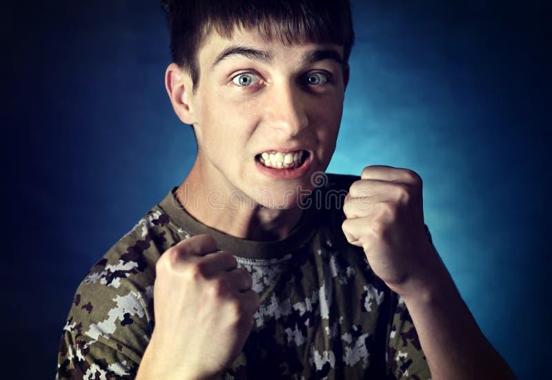 сердитые детеныши человека стоковая фотография rf