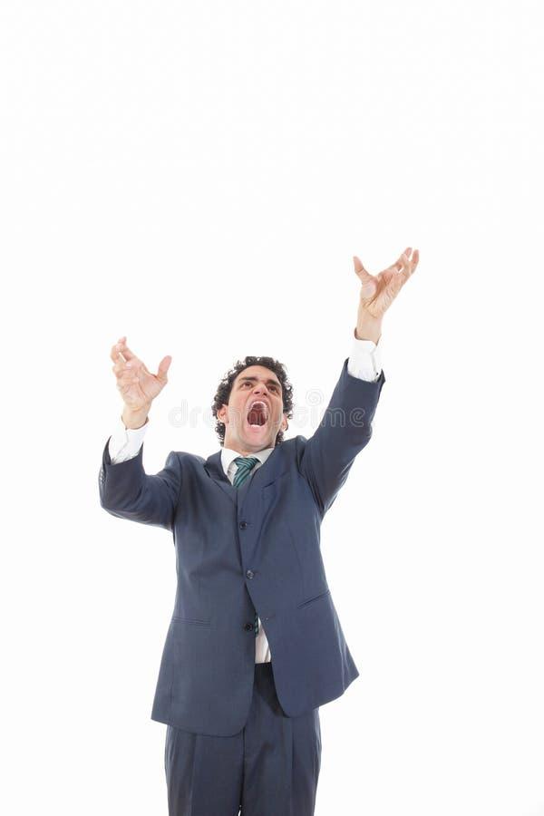 Сердитый бизнесмен пробуя достигнуть для что-то сверху стоковое фото rf