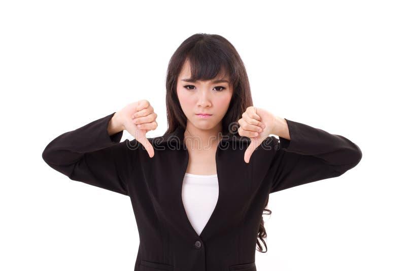 Сердитый, расстроенный давать коммерсантки, показывая большой палец руки вниз стоковая фотография rf