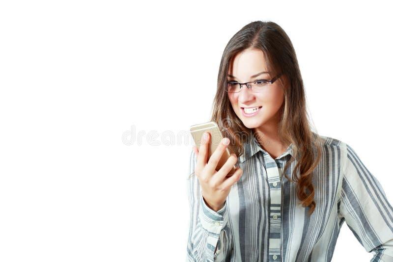 Сердитый телефон женщины стоковые фото