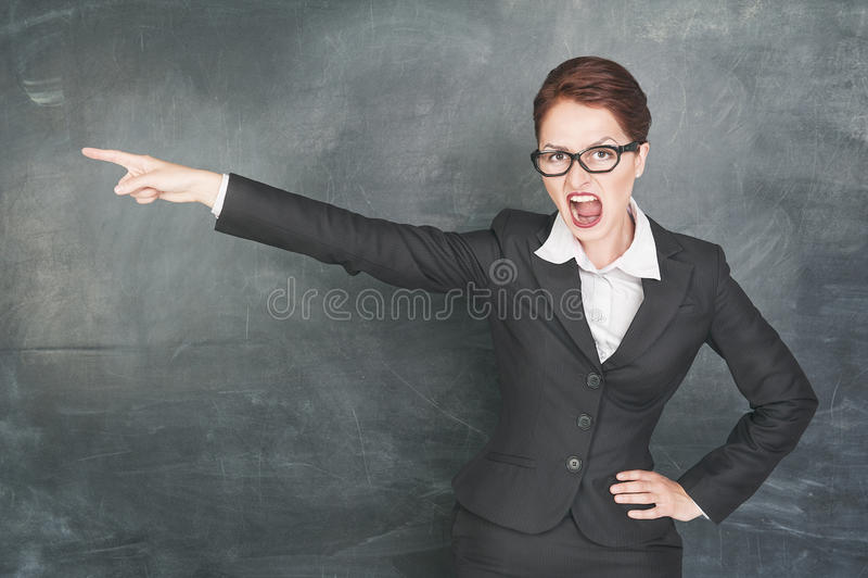Сердитый учитель указывая вне стоковые изображения rf