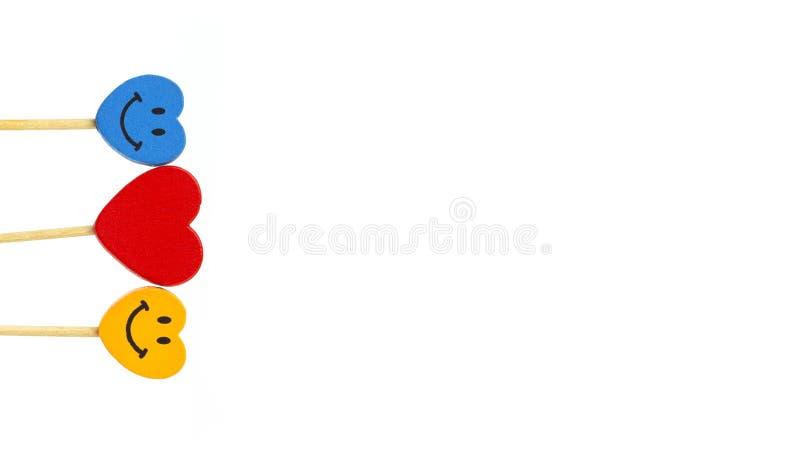 Сердце между 2 сторонами улыбки в белой предпосылке 4 стоковые изображения rf