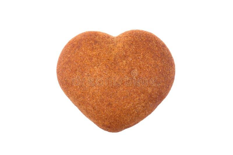 Сердце меда сформировало печенье изолированное на белой предпосылке стоковое изображение rf