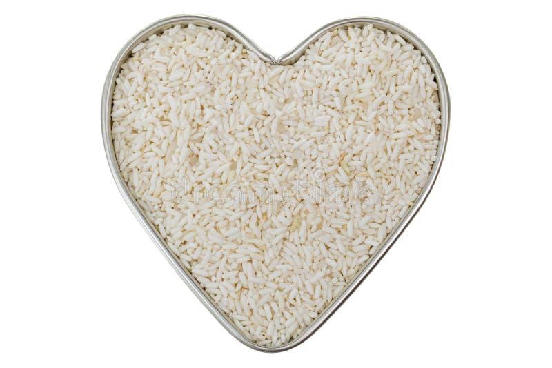 Сердце сформировало лоток олова вполне сырцового белого липкого риса, Glutinous ri стоковая фотография