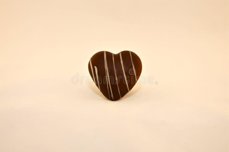 Сердце шоколада с нашивками стоковые изображения