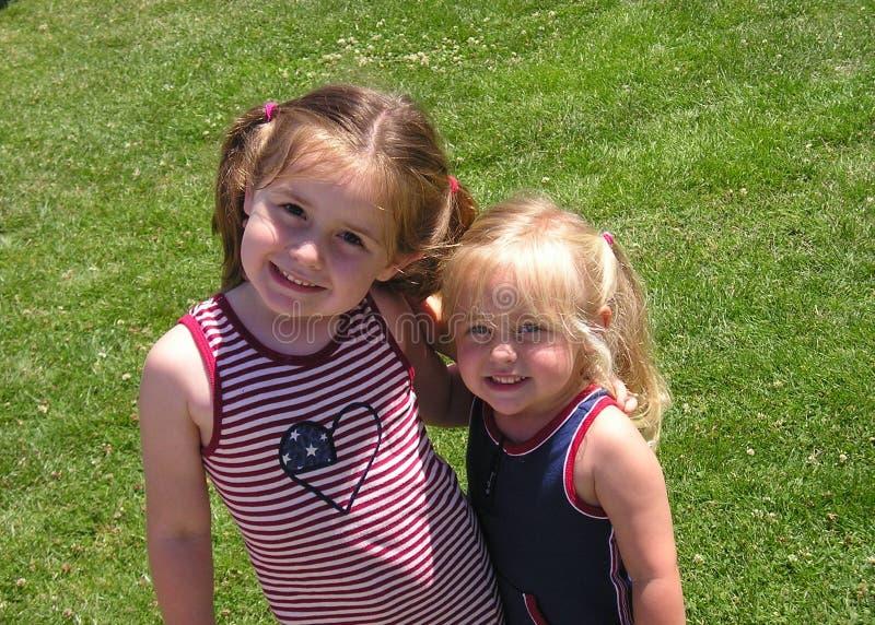 Сестры на четверти от июля стоковое фото