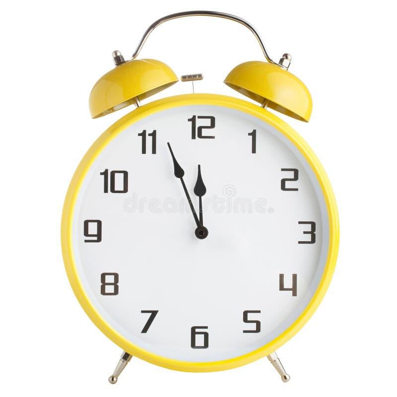 Сетноой-аналогов желтый будильник изолированный на белой предпосылке стоковые фото