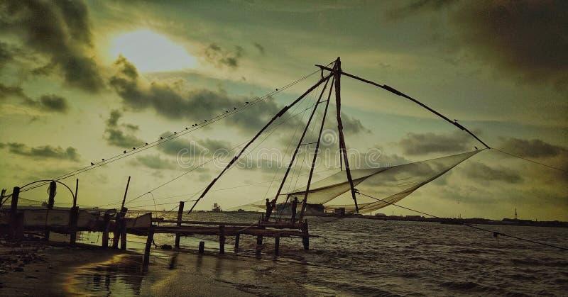 Сеть рыб используя fishermans стоковые изображения rf