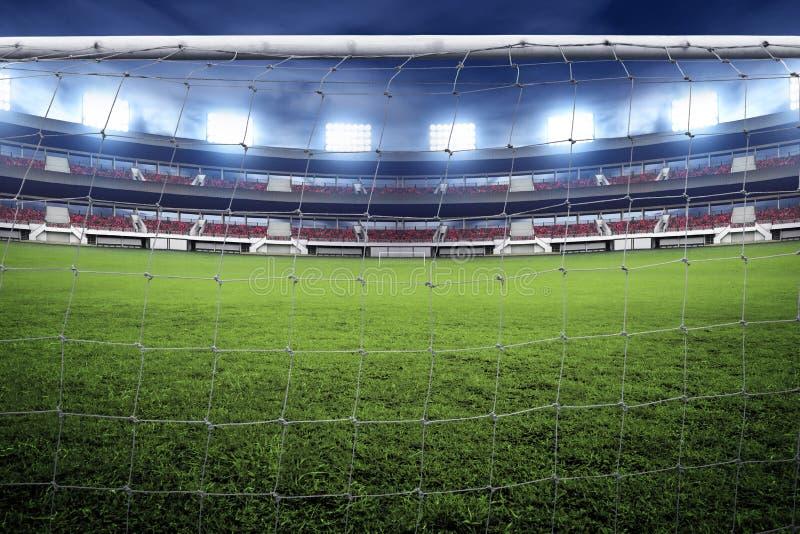 Сеть цели футбола на стадионе стоковая фотография