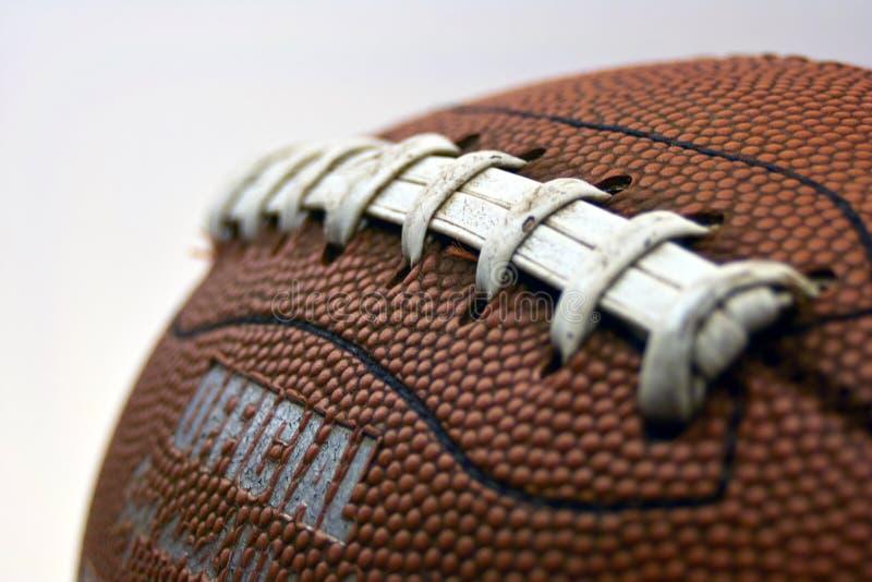 сжатие футбола стоковое изображение