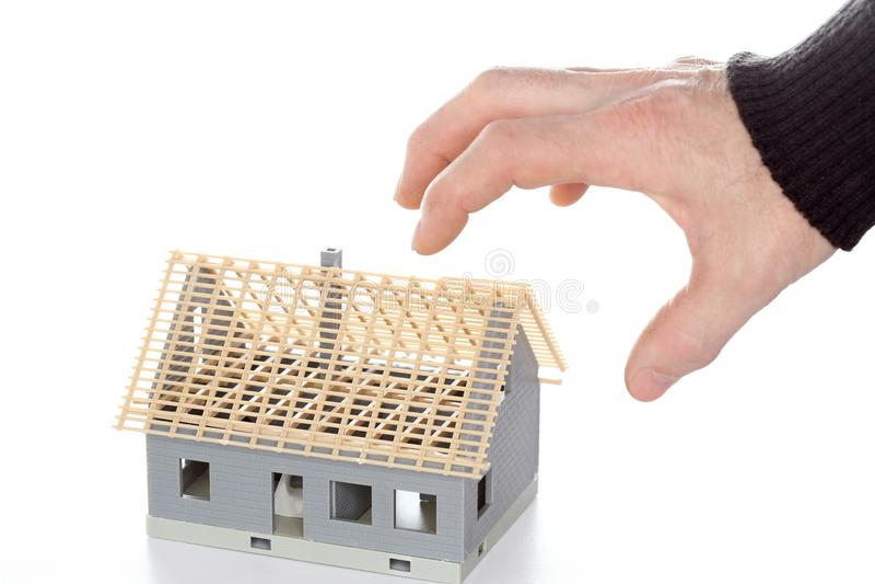 Сжимать модель руки и дома стоковая фотография