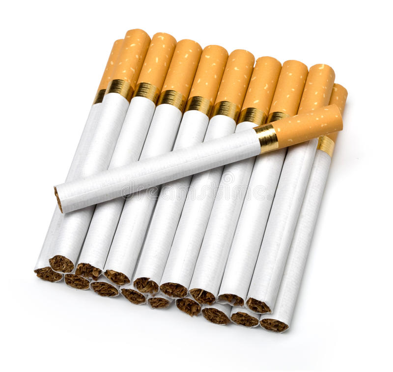 Сигареты табака изолированные на белизне стоковое фото