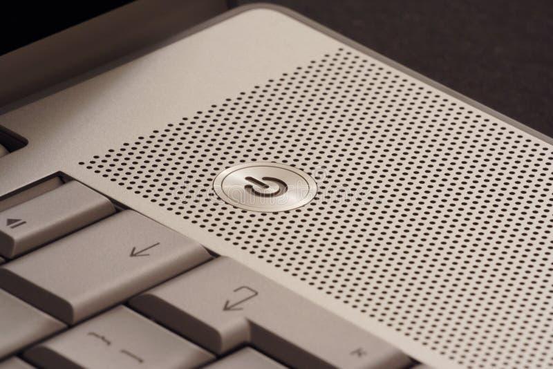сила компьтер-книжки кнопки стоковое изображение