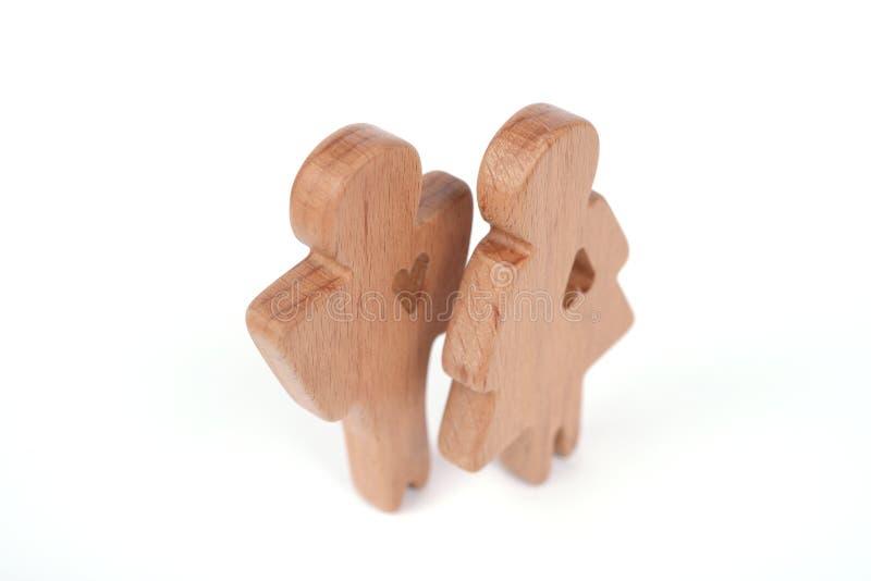 Силуэты человека, женщины и сердца отрезали вне внутри форм на белой предпосылке влюбленность пар счастливая Мужчина и женщина, о стоковое изображение rf