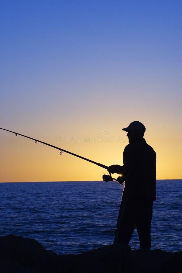 силуэт рыболова стоковые изображения rf