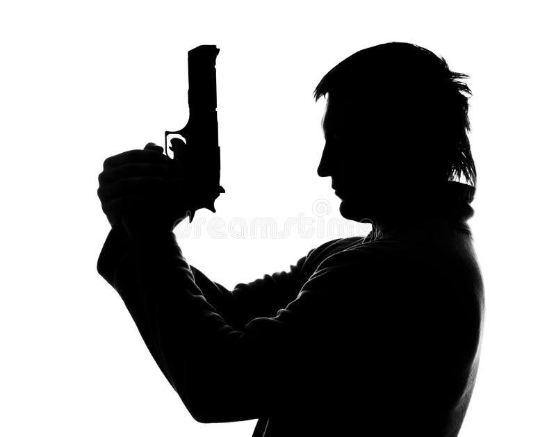 силуэт стрельбы человека стоковое фото