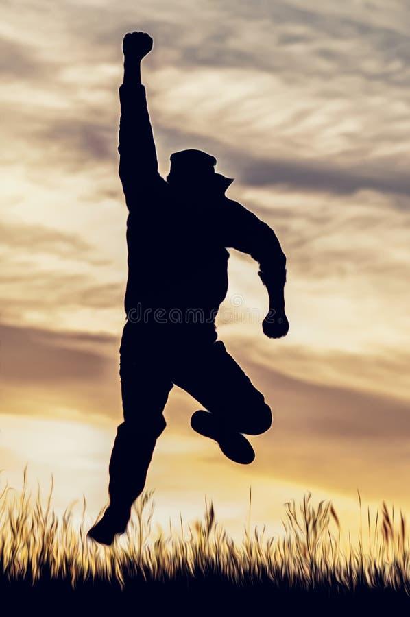 Силуэт человека в скачке с его рукой расширенной стоковое фото