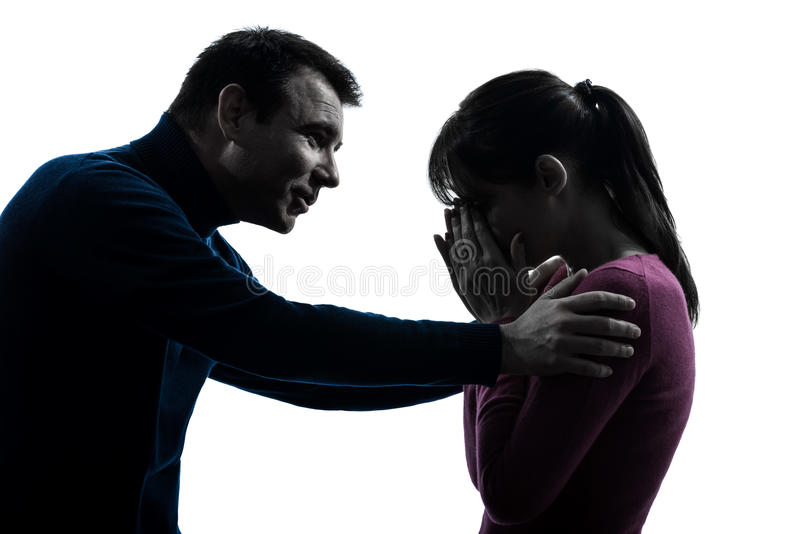 Силуэт человека женщины пар плача утешая стоковая фотография rf
