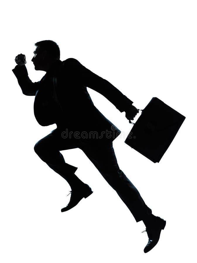 силуэт человека одного дела скача идущий стоковое фото