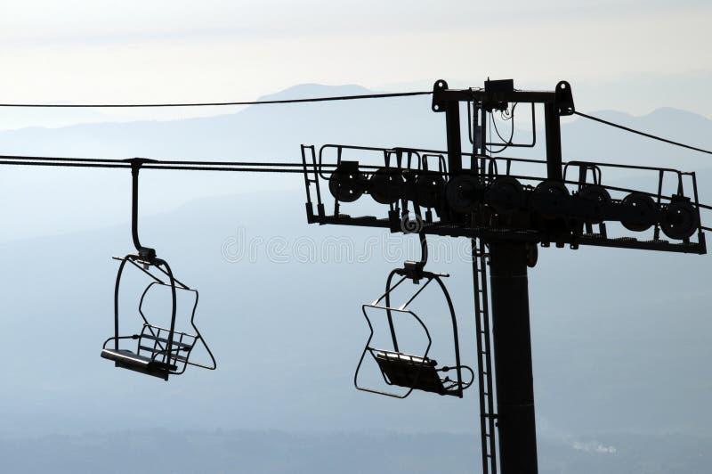 силуэт semnoz Франции chairlifts стоковое фото