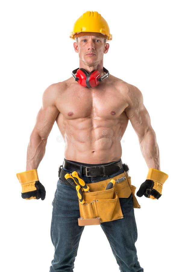 Сильный рабочий-строитель стоковые фото