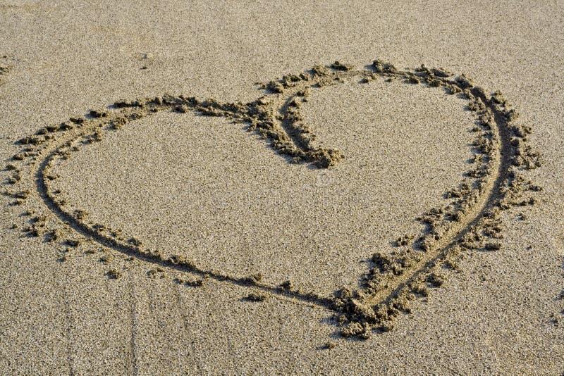 символ песка влюбленности стоковая фотография rf