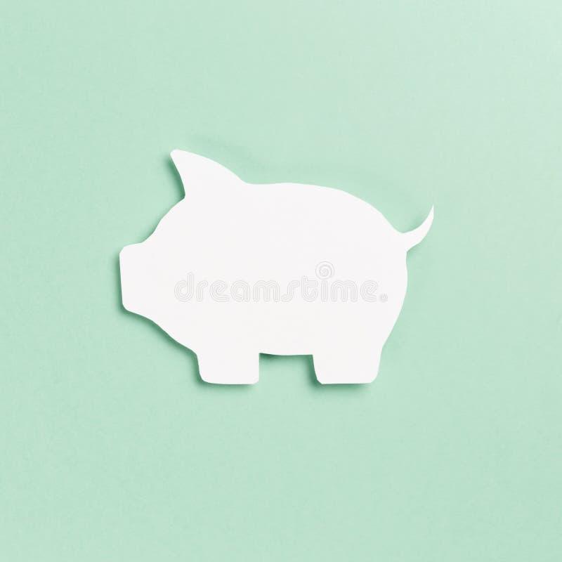 Символ свиньи на предпосылке мяты стоковая фотография
