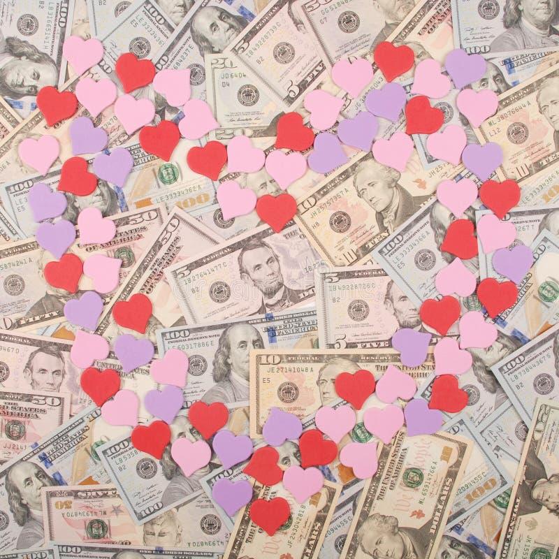 Символ сердца на предпосылке денег стоковые изображения rf
