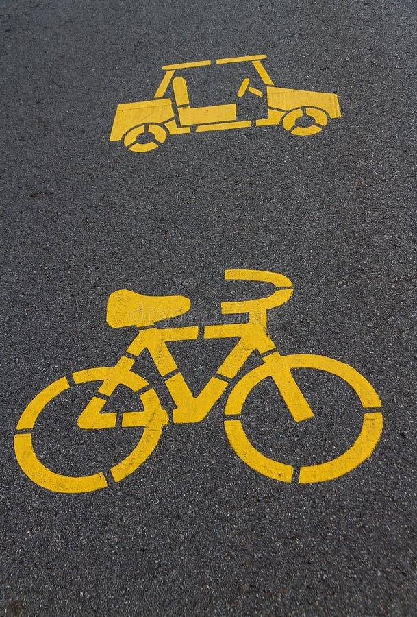 Символ велосипеда и автомобиля стоковое фото