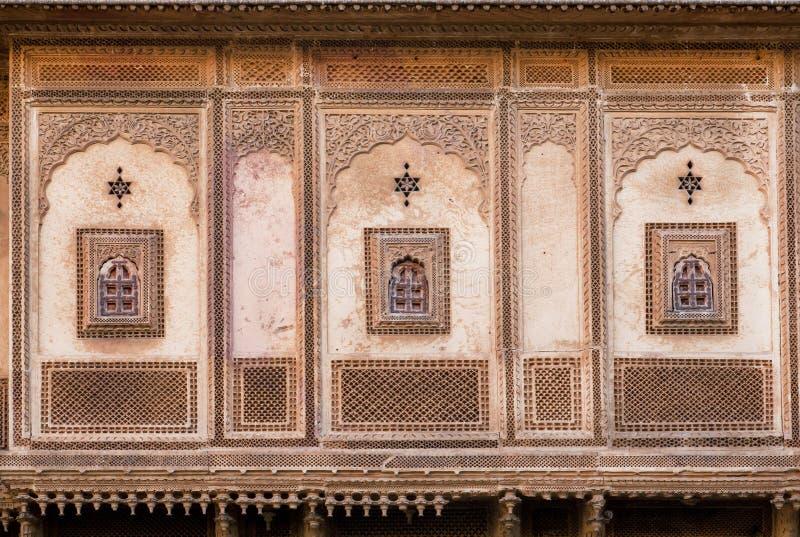 Символы и картины на древней стене стоковое фото rf