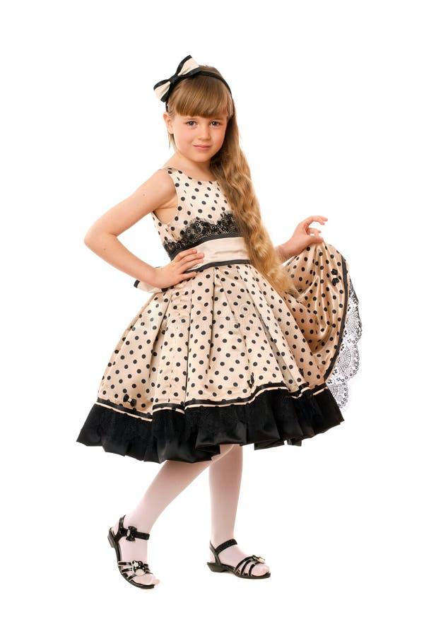 Симпатичная маленькая девочка в платье стоковое изображение
