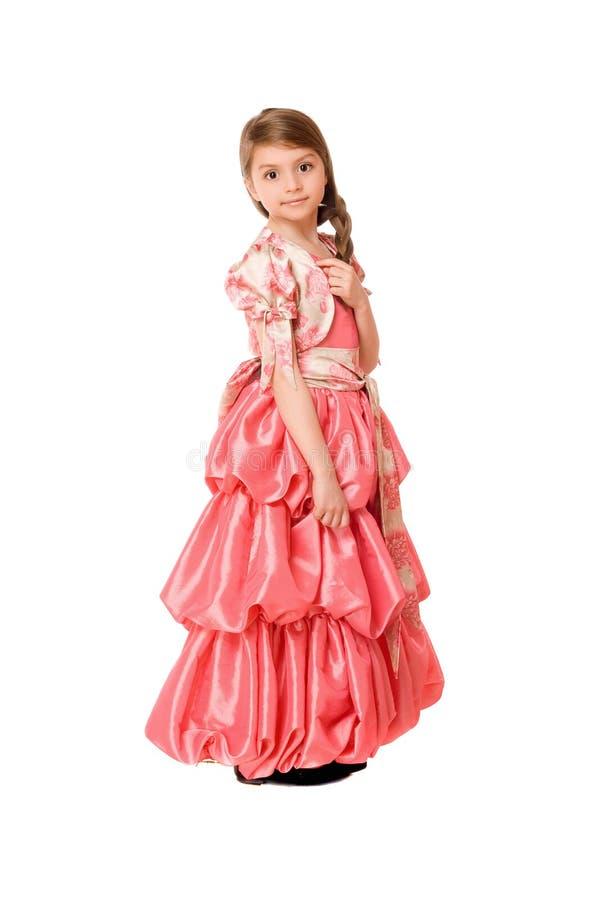 Симпатичная маленькая девочка в длинном платье стоковые изображения