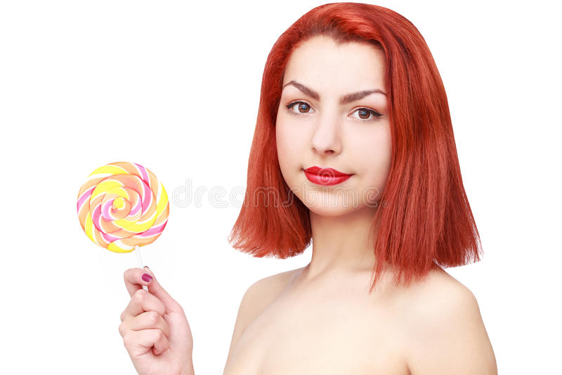 Симпатичная молодая женщина с lolipop, на белой предпосылке стоковое фото rf
