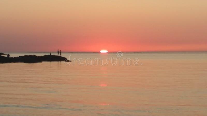 Симпатичный заход солнца стоковое изображение