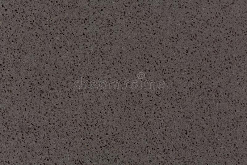 Синтетическая текстура камня кварца, темный серый тон стоковое фото rf