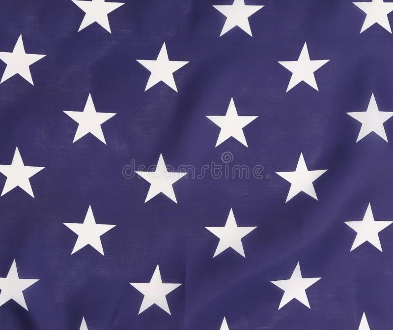 Синь американского флага подсвеченная с белыми звездами. стоковые изображения rf