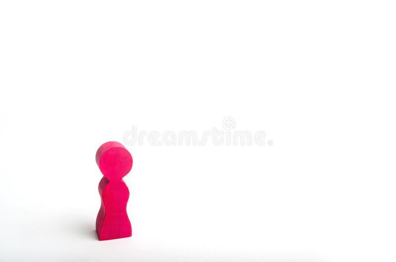Сиротливая розовая деревянная диаграмма девушки Концепция гомосексуализма лесбосская женщина стоя на белой предпосылке установьте стоковое фото rf