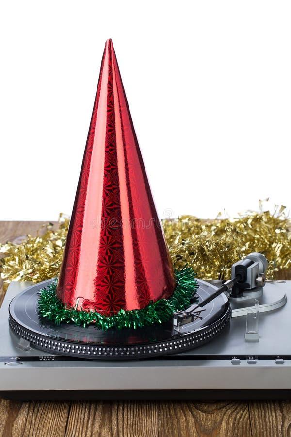 Сияющая шляпа партии на рекордном игроке стоковые изображения