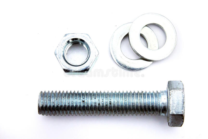 Сияющие стальные гайка наговора металла, болт установки и шайба на белом b стоковые фото